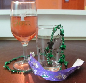 Our souvenir wine and beer glasses, wrist bands, and Mardi Gras beads