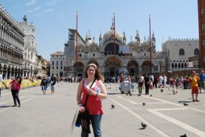 Me holding gelato in front of San Marco Basilica in Venice
