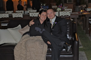 Tom and Sharolin cuddling up at our wedding this past fall